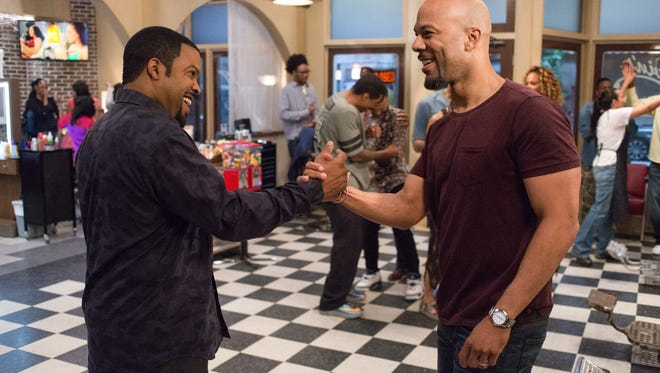 """Ice Cube (left) and Common co-star in """"Barbershop: The Next Cut."""""""