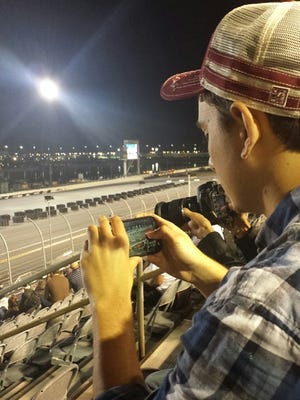 A fan using the Verizon Wireless network at a racing event.