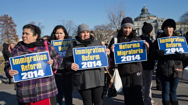 Immigration activists gather on Capitol Hill on Dec. 12, 2013, to appeal for action on an immigration bill.