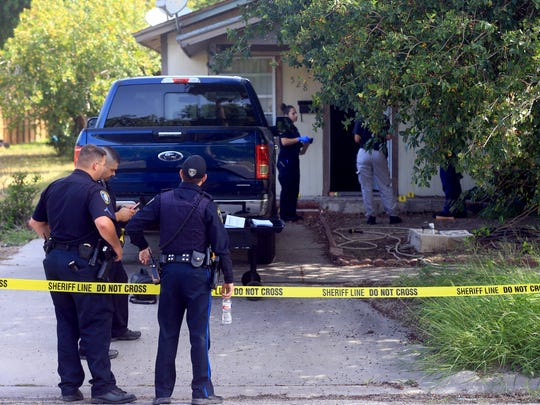 Kingsville police officers investigate a home after a fatal stabbing was reported on the 500 block of Henrietta Dr. on Saturday, July 1, 2017, in Kingsville.