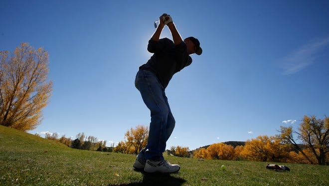 Rod Wimsatt tees off on Tuesday at Hidden Valley Golf Course in Aztec.