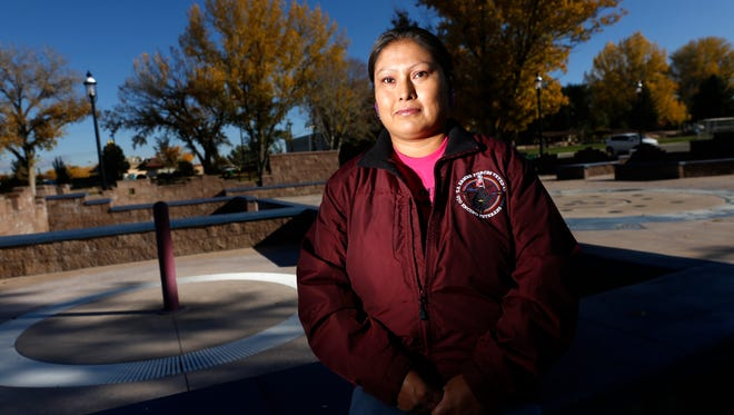 Sherilynne Juan, who served in the U.S. Army for eight years, poses for a photo on Friday at Minium Park in Aztec.