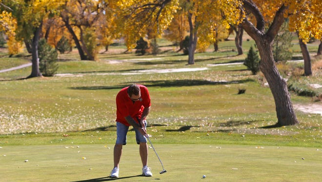 Donnie Snell putts Nov. 3 while playing a round at the Hidden Valley Golf Course in Aztec.