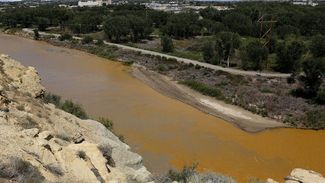 Water from the Animas River mixes with the San Juan River on Aug. 8, 2015, shortly after the Gold King Mine spill.