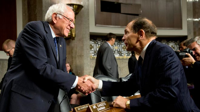 Veterans Affairs Secretary nominee Robert McDonald, right, shakes hands with  Senate Veterans' Affairs Committee Chairman Bernard Sanders, I-Vt., at the conclusion of the committee's hearings to examine his nomination to be Secretary of Veterans Affairs on Capitol Hill in Washington, last Tuesday.