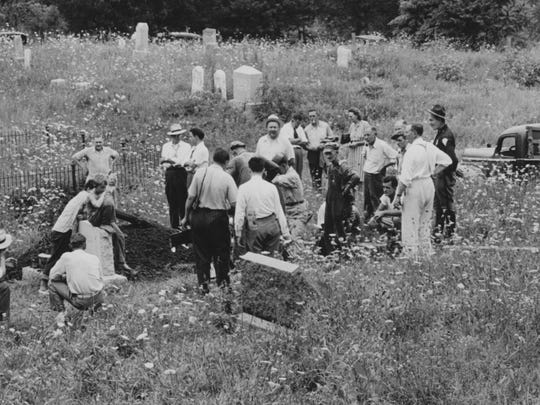 "Children gathered to watch the exhumation of a body in Dupont, Indiana, in the mercury poisoning case of Lottie ""Tot"" Lockman in 1947."