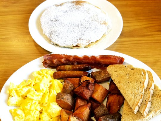 NicMarc Diner's Big Hearty Breakfast was basically a breakfast buffet on a plate. The platter came with two eggs your way, two strips of crispy bacon, two links of sausage, two huge sweet cream pancakes topped with powdered sugar, home fried potatoes and two slices of buttered toast.