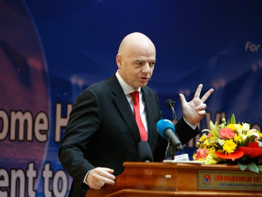 FIFA President Gianni Infantino gestures during a news conference in Hanoi, Vietnam, Thursday, Feb. 8, 2018. Infantino is on a one-day visit to Vietnam to discuss with Vietnamese leaders on how the world soccer body can further help the communist country develop its soccer. (AP Photo/Tran Van Minh)