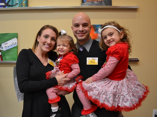 Brandywine Hundred's Painting with a Twist owners Stephanie and Jay Pomante with their daughters.