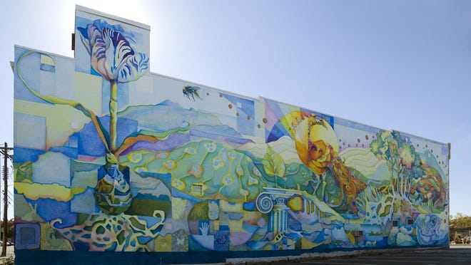 The Divine Porportion of All Things at 714 Washington Ave., Covington, celebrates the bounty of the land and interconnected elements of life: water, earth and air that symbolize how a community depends on each other to live in harmony.