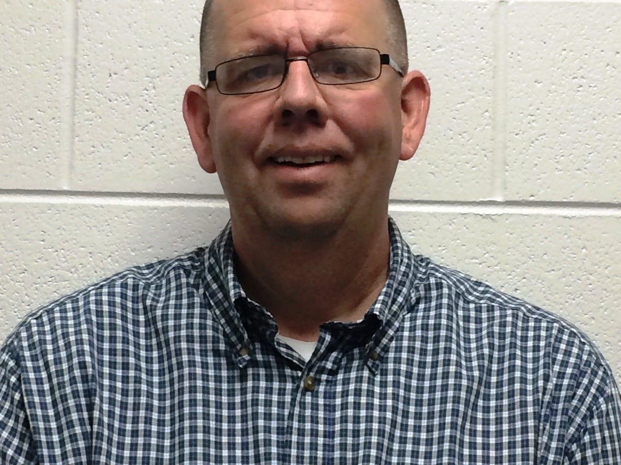 "Bellevue head football coach John ""Woody"" McMillen."