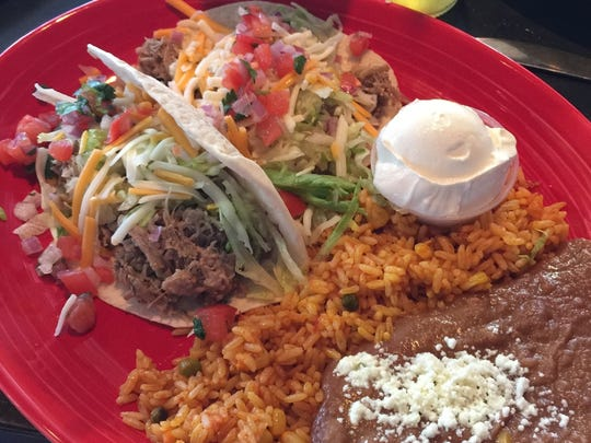 Roast pork carnitas with rice and refried beans at Spicy Cantina in Seaside Heights.