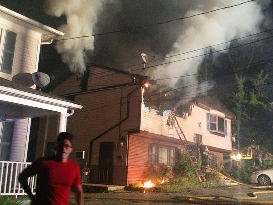 Smoke comes out of a home at 5 Highland Ave. in Netcong.