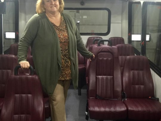 Susan Newbrough, transit manager for Virginia Regional Transit, stands inside one of the new BRITE buses.