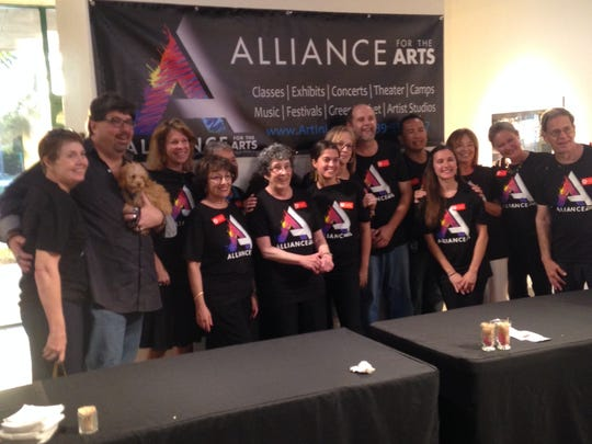 Alliance supporters gather to show off T-shirts emblazoned with the new logo.