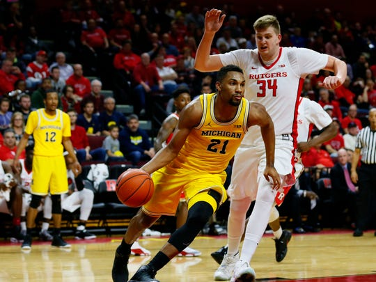 Feb 22, 2017; Piscataway, NJ, USA; Michigan Wolverines guard Zak Irvin drives against Rutgers Scarlet Knights center C.J. Gettys during the first half at Louis Brown Athletic Center.