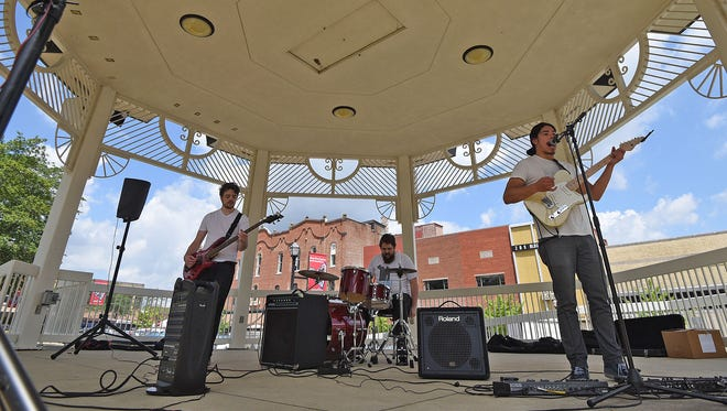 Members of the band Oddepoxy perform Friday afternoon in Mansfield's Central Park for the Brown Bag Luncheon Series. Live music can be heard in the park on the second Friday of every month through Sept. 8.