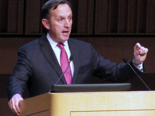 Clark Kinlin, Corning Inc. vice president and head of the company's optical communications division, addresses company shareholders Thursday at the Corning Museum of Glass.