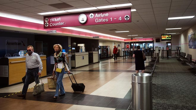Passengers from a returning American Airlines flight make their way through the terminal at Abraham Lincoln Capital Airport Friday, June 5, 2020.
