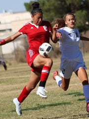 Valencia's Camila Orozco tries to win possession of a ball while being defended by Alamogordo's Sheyenne Drake.
