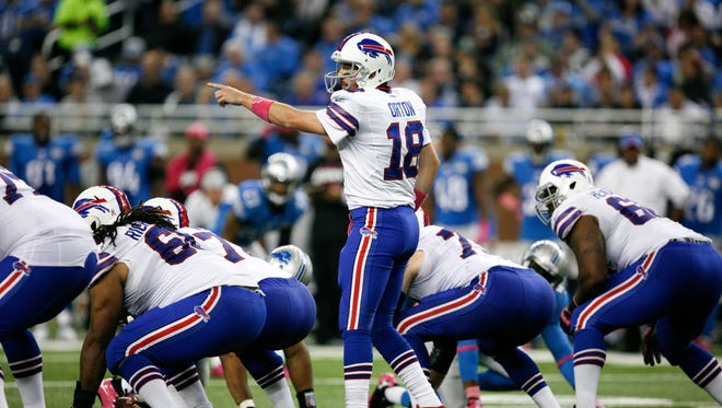 Buffalo Bills quarterback Kyle Orton (18) points down field during the third quarter against the Detroit Lions at Ford Field.