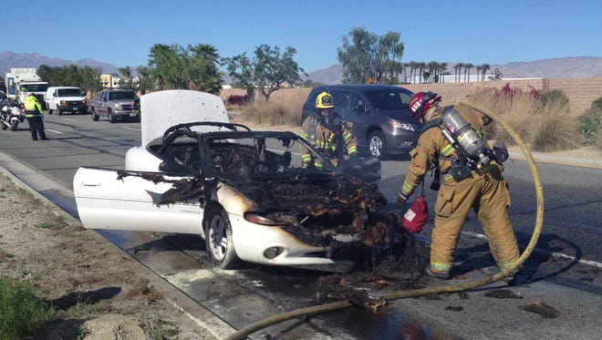 Palm Springs firefighters put out a car fire on Gene Autry Trail Tuesday. The fire slowed traffic, but the car's occupants were not hurt.