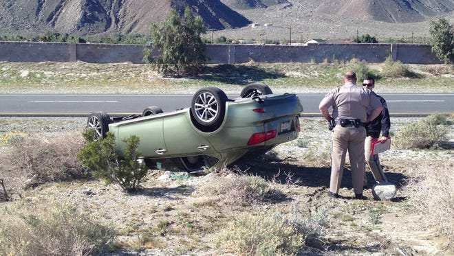 A Lexus overturned on Highway 111 at Overture Drive Tuesday in North Palm Springs.
