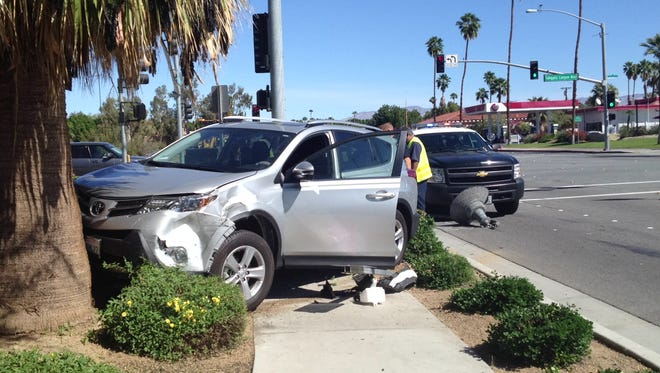 A Toyota SUV collided with a Ford Expedition before stopping on a sidewalk at Sunrise Way and Tahquitz Canyon Way in Palm Springs Wednesday morning.