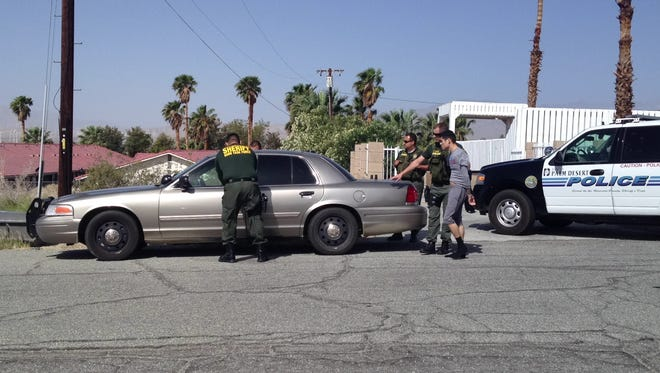 Two suspects are arrested at 11-901 Verbena Drive in Desert Hot Springs as part of a Coachella gang sweep on Wednesday.