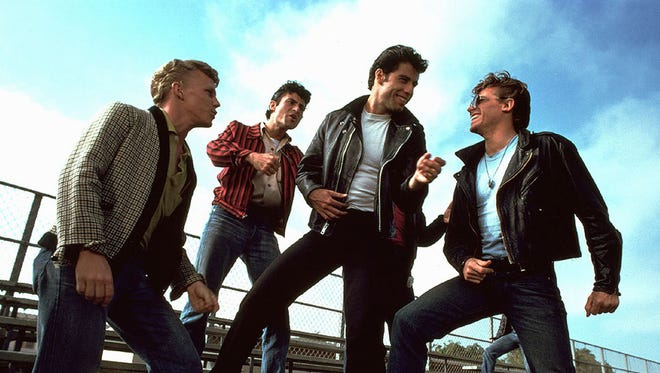 A scene from the 1978 musical 'Grease.' From left: Kelly Ward, Barry Pearl, John Travolta and Jeff Conaway.