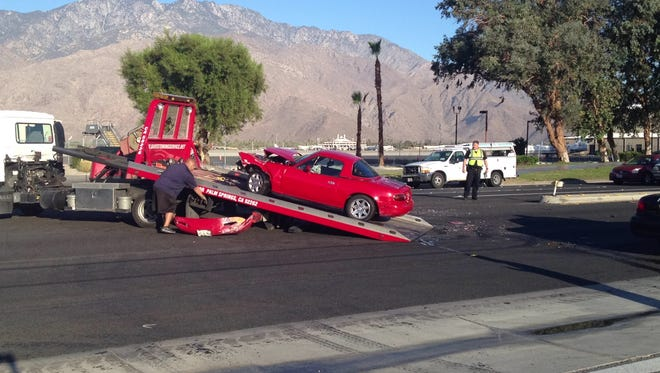 A Mazda Miata was damaged after colliding with a Palm Springs Unified School District maintenance truck's trailer on Gene Autry Trail Wednesday.