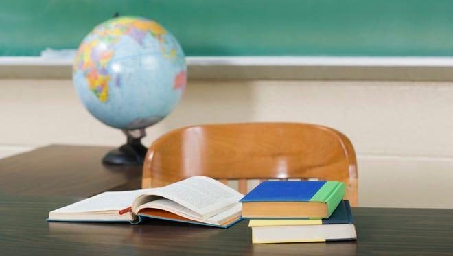 A desk and books.