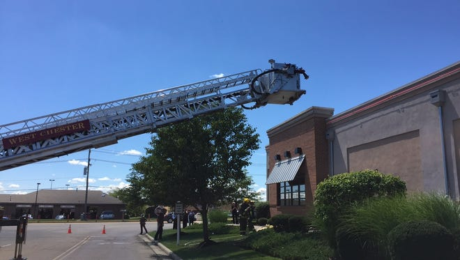 West Chester Township Fire crews work to put out fire that closed the Longhorn Steakhouse on Voice of America Drive in Butler County. The lunch time fire caused no injuries and undetermined damage.