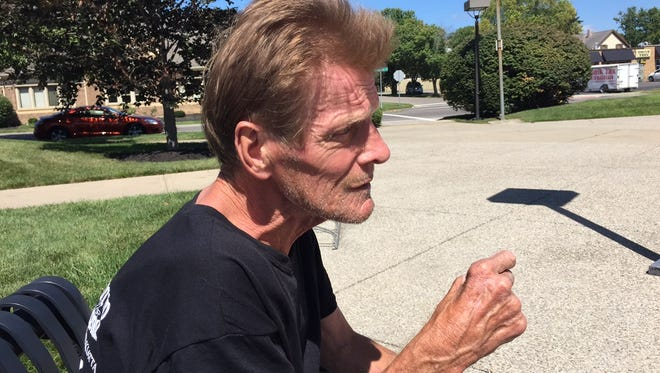 John McIntosh, 64, says he is homeless in affluent Mason. The man who walks with a cane around the city's historic business district has become most talked aobut on The Enquirer's Mason facebook page with hundreds posting concerns about him