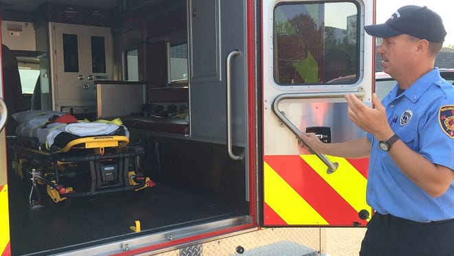 Todd Forcier of the Wisconsin Rapids Fire Department, discusses some of the features of the department's new ambulance.