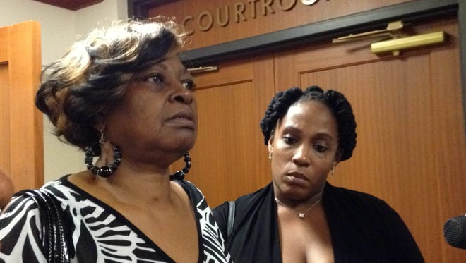 Audrey DuBose, at left, talking to reporters Wednesday outside Judge Ralph Winkler's courtroom in Hamilton County Probate Court.