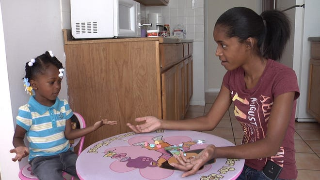 """Shurand Adams of Calumet City, Ill., says her daughter, Teshyia, is """"picking things up quickly"""" because of the three T's."""