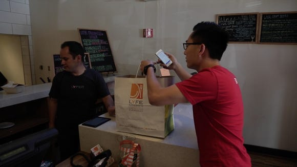 Tony Xu picks up an order for DoorDash from Lyfe Kitchen