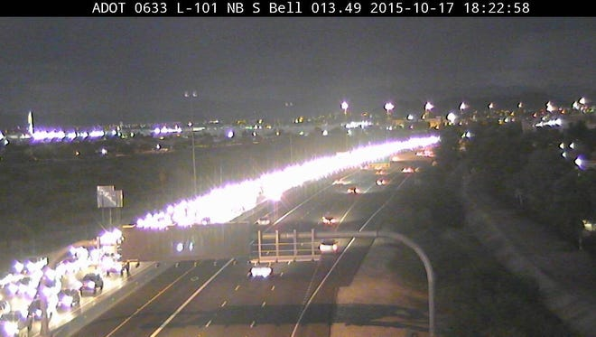 A crash involving a motorcycle and car backed-up traffic on Loop 101.