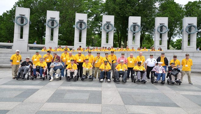 Veterans and their guardians pose for a photo in Washington, D.C., during a Screaming Eagle Honor Flight.