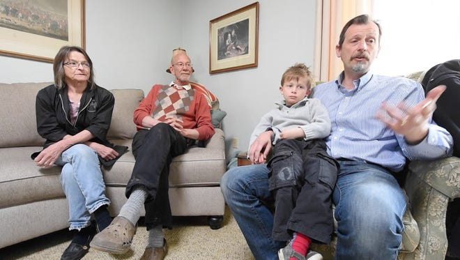 From the left, Rose-Marie Walsh, Chris Walsh, Yann Soenen, 5, and his father, Bruno, talk about Belgians not being surprised by Tuesday's terrorism  in Brussels.