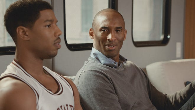 Los Angeles Lakers star Kobe Bryant, right, chats with actor Michael B. Jordan in an ad for Apple TV.