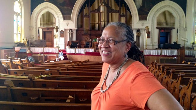 The Rev. Jamesetta Ferguson, pastor of St. Peter United Church of Christ, 1225 W. Jefferson St., is shown in 2014 in the church sanctuary in 2014, before pews were sold.