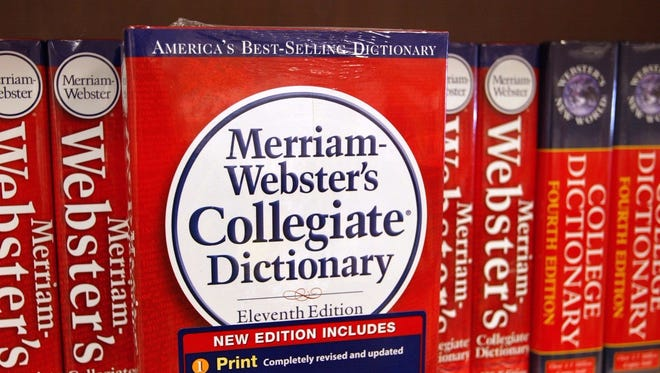 A Merriam-Webster's Collegiate Dictionary is displayed in a bookstore