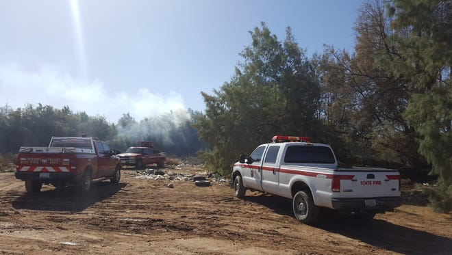 Buckeye and Arizona State Forestry fire crews battle Gila River bottom fire Sunday afternoon.