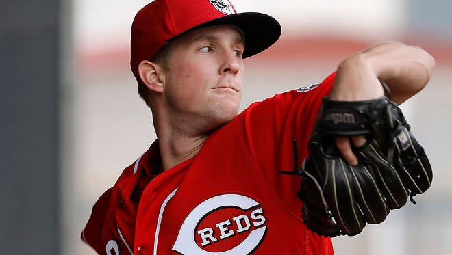 Cincinnati Reds' Layne Somsen throws during a spring training baseball workout Thursday, Feb. 18, 2016, in Goodyear, Ariz. (AP Photo/Morry Gash)