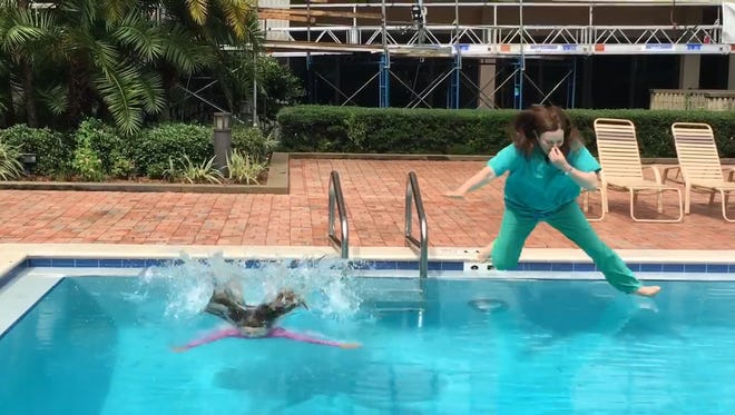 Two people in Florida participate in the Belly Flop for Babies Challenge.