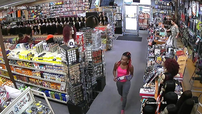 This woman is a person of interest in a theft investigation at Beauty World on Vann Drive in Jackson.