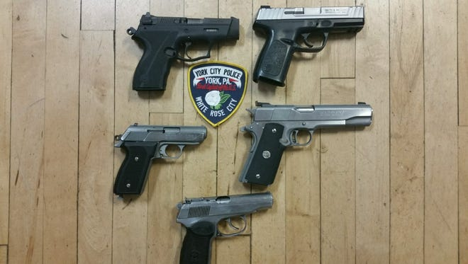 Five handguns seized in a drug raid by York City Police on Friday, in which four adults and two juveniles were arrested.