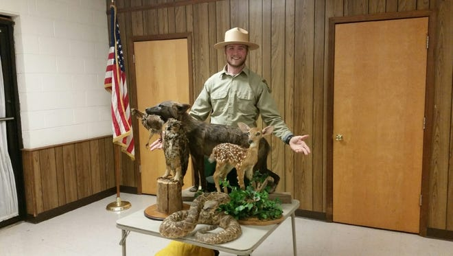 Shown is Jacob Dean with a display of lifelike animals for discussion. The species of animals represented are also found in the Tugaloo State Park for sightseeing.